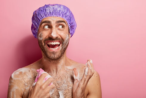 body-care-concept-happy-guy-takes-shower