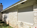 Stucco Solar Screens on old Central Austin limestone home.