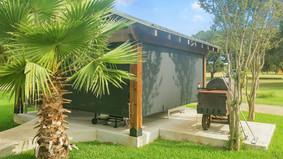 Black sun control fabric Round Rock TX roll down patio shade.