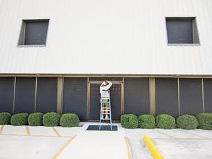 Commercial solar screens shading windows - Austin TX.