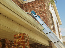 Don't damage your gutters with a ladder.