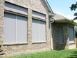 Grey solar screens to shade your home's windows.