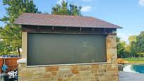 Round Rock TX exterior patio shades brown fabric.