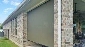 Austin outdoor solar shades brown fabric.