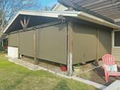 Pretty exterior sun shades Cedar Park Texas New Brown fabric.