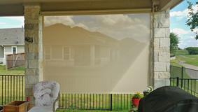 Beige fabric color Austin Texas retractable patio shade.