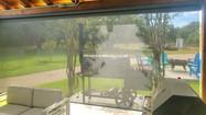 Leander Texas patio solar shades Black sun control fabric.