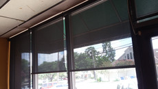 Office blinds for each window panel.