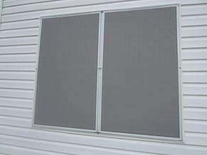 Two 90% grey fabric solar window screens.