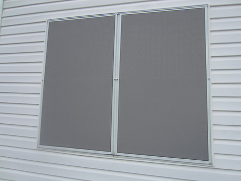 Two 90% grey fabric solar window screens.
