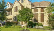 Round Rock Texas home's windows now shaded from the sun with my Mocha 90% Tan frame solar screens.