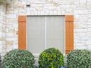 Stucco fabric solar screens for windows South Austin 2012 installation.