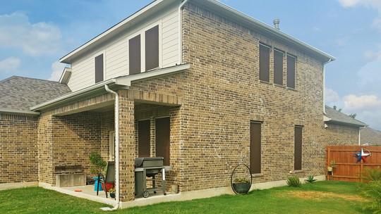 Hutto Texas house is being sun shaded w/ my Mocha Tan solar window screens.