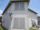 Gray fabric solar window screens.