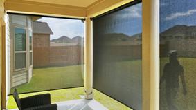 Black solar shade color retractable sun shade Leander Texas.
