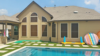 Back side of home in Pflugerville TX shaded from the sun with my Mocha 90% Tan solar screens.