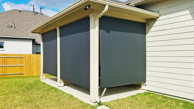 Exterior roller shades Pflugerville TX Black solar fabric.