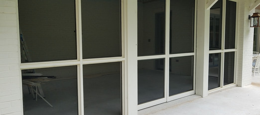 Custom wood framed patio with bug screens.