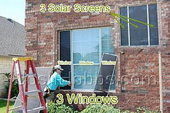 Side by side window solar sun shade screens.