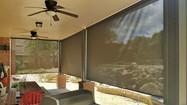 Retractable patio screens Austin TX brown fabric.