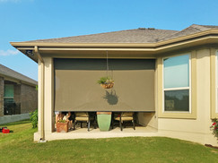 Brown solar fabric retractable sun shade Austin Texas.