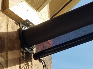 Georgetown TX sun shades for the patio mounted with tapcons to brick.