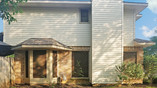Mocha 80% Tan frame Pflugerville Texas solar window screens. You can see the blinds, not too dark.