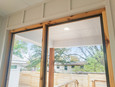 Screened in wood framed patio encloser.
