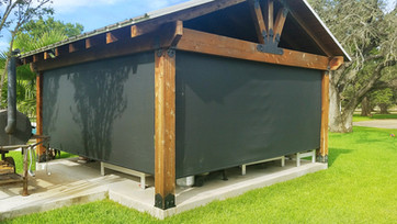 Outdoor roll up blinds  Round Rock TX Black sun shade fabric.