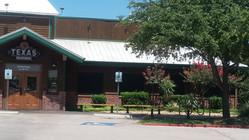 Round Rock - Texas Roadhouse wearing Josh Hobbs solar screens for windows.