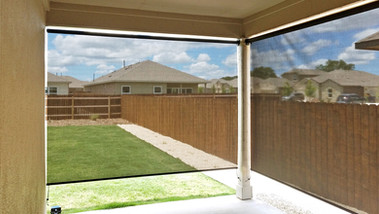 Brown sun shade fabric outdoor blinds for porch Pflugerville Texas.