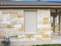 Stucco fabric and the Austin limestone.
