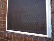 Solar screen shading Builders First Source vinyl window Austin TX.