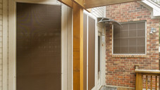 North Austin Mocha 80% and 90% Champagne solar screens. Put on white framed windows.