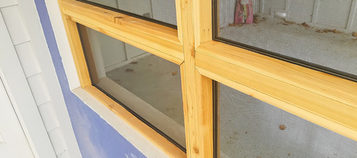 Screened in patio made of wood.