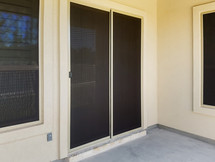 Eliminate heat coming in through the doors with solar screens.