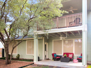 Stucco fabric solar screens for Austin home.
