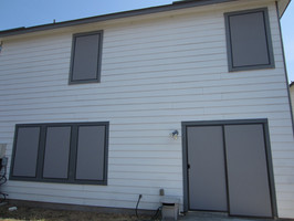 Grey solar screens brown frame with sliding door solar screens.