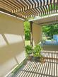 Pflugerville TX retractable shade Beige sun shade fabric.