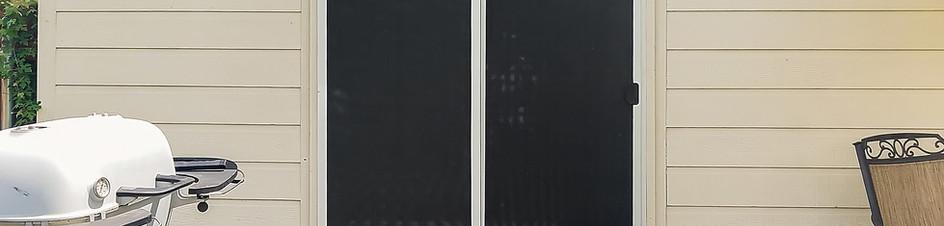 Black 90% sliding solar screen door w/ fixed solar pocket door.