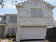 Grey solar screens on home in Leander TX.