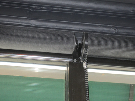 Window covering commercial roller blinds for offices.
