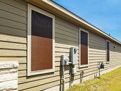 Beautiful 90% fabric mocha solar screens with tan frame.