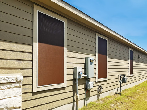 Beautiful 90% fabric mocha solar screens with tan frame.
