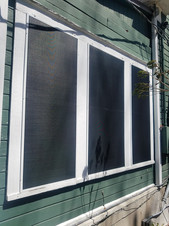 Solar screens on wood windows, surface mounted.