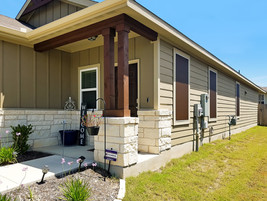 Buda solar screens install using mocha color fabric. Goes with house well.