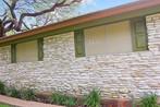 Pretty home wearing my Beige solar window screens.