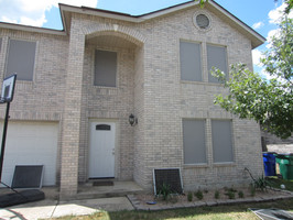 Grey solar screens Buda Texas home.
