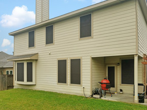 Back of Pflugerville TX home with shaded windows from my solar screens.