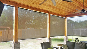 Looking out New Brown exterior roller shades Cedar Park TX.